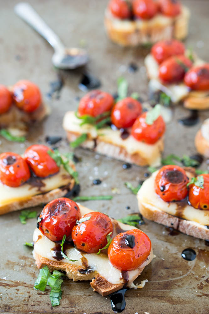 Image result for Tomato and Mozzarella on a Pesto Crostini with a Balsamic Drizzle