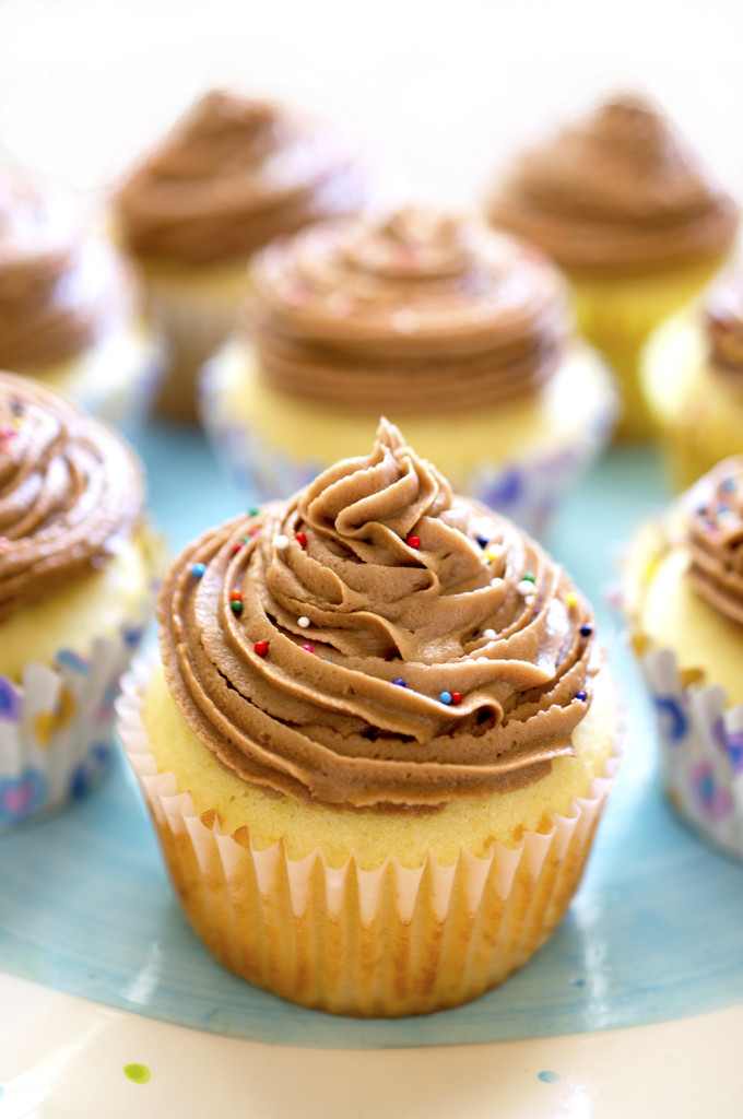 Yellow Cupcakes with Nutella Buttercream Frosting | chefsavvy.com #recipe #dessert #cupcake #chocolate