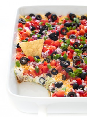 top shot of easy 7-layer dip in white baking dish