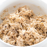 top shot of shredded crab cake mixture in white bowl