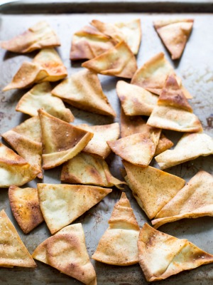 Super Easy Homemade Spicy Pita Chips. So much better than store bought. Only 4 ingredients and ready in less than 15 minutes!